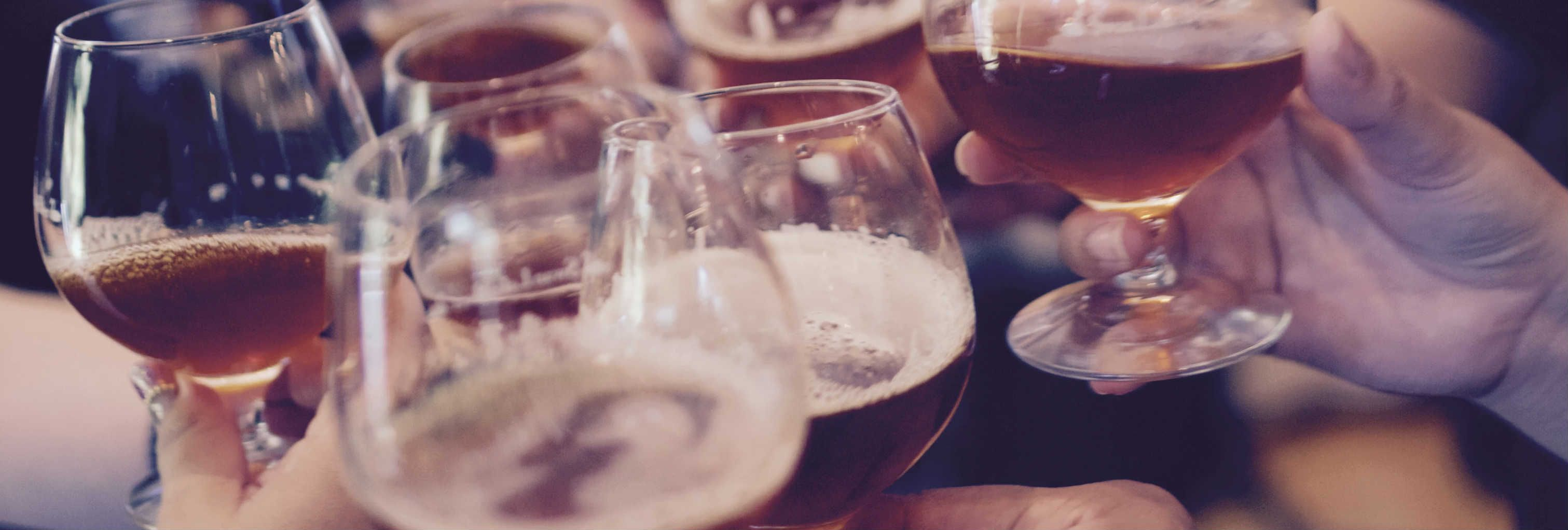 close up of people holding glasses of beer