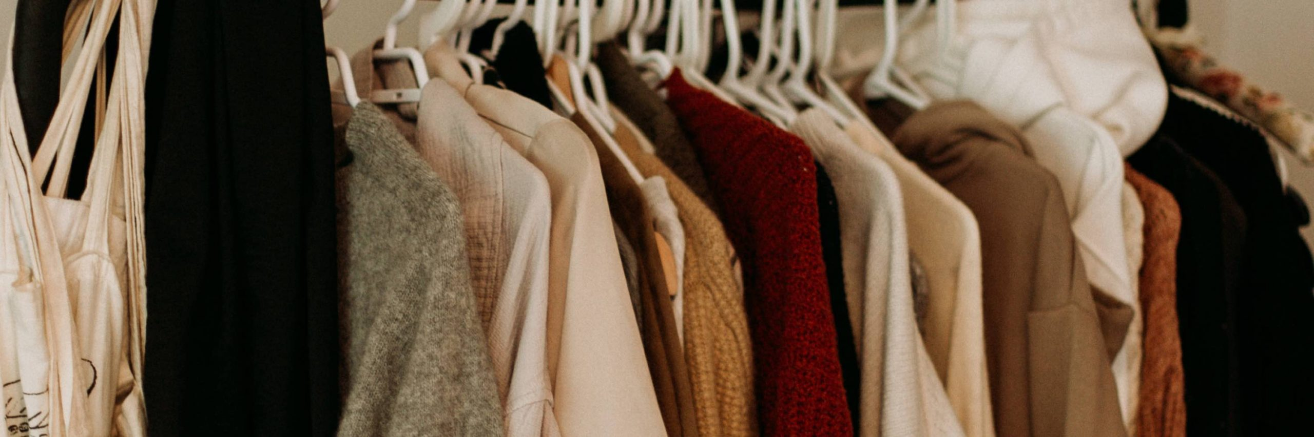 Sweaters on rack demonstrating loungewear. Image from Priscilla du Preez on Unsplash.